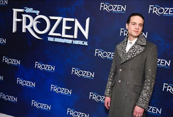 Jordan Roth in Zac Posen coat